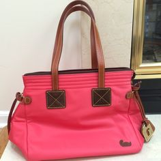 Dooney & Bourke Tote Bag Used twice, this tote is in excellent condition. No stains, tears & in new condition. It is a beautiful coral color, perfect for spring/summer. Only selling bc since having kids I only carry a diaper bag. :( Dooney & Bourke Bags Totes