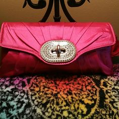 Pretty in Pink Bling-out Silky purse /cross body. Fuchsia Pink a beautiful  with crystal rims stones center piece medallion that has twisting  closure. Also for extra security interior pockets with zipper closure and fully silk lined. Can be carried as a cross body or  shoulders..& Clutch come with  detachable  silver tone straps XOXO Bags Clutches & Wristlets