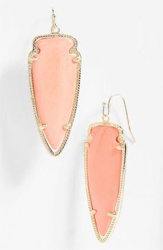 The earring shape mimics the facial shape, and movement/direction of the facial features. Different colors available that would work with the palette. Kendra Scott 'Skylar Spear' Statement Earrings | Nordstrom