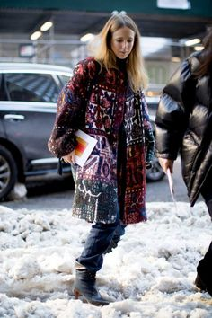 In A Tapestry Coat And Chloé Boots