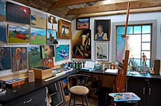 paint studio: easel, canvass, tarp for floor, paints strewn about, glass jar of brushes