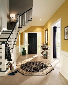 1) Yellow: Amber Brew Yellow is, predictably, our #1 happy color. We love how this home used Amber Brew to bring some sunshine into their space above the beautiful chair rail molding of their entryway. This golden hue is a sophisticated take on yellow.