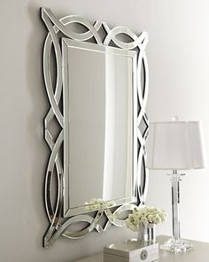 """Miramar"" Figure-8 Mirror at Neiman Marcus.    Made of wood composite and glass.  32""W x 0.5""D x 42""T.  $495 + 115 for shipping"