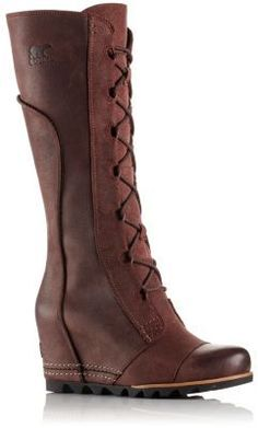 The SOREL Women's Cate The Great waterproof wedge has a full-grain leather and oiled suede upper, a microfiber lining and a removable, molded EVA footbed.