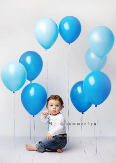 Tape balloons at different lengths for backdrop