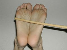 caning the soles (Barefoot Alvin) Tags: feet cane foot pain toes toe legs leg barefoot whip barefeet sole soles punishment painful whipping caning bastinado falaka baresole baresoles