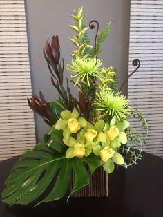 Send the Nick – Tropical Greens bouquet of flowers from Elizabeth Marks Floral Design in San Diego, CA. Local fresh flower delivery directly from the florist and never in a box! Contemporary Flower Arrangements, Tropical Flower Arrangements, Flower Arrangement Designs, Church Flower Arrangements, Orchid Arrangements, Beautiful Flower Arrangements, Flower Centerpieces, Tropical Flowers, Tall Centerpiece
