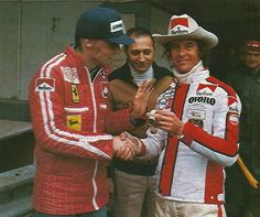 Niki Lauda thanks Arturo Merzario at Monza for saving his life. It was Merzario who freed Lauda from his burning Ferrari at the Nurburgring. Merizario a former Ferrari driver knew how to work the seat belts. Ironically, Merzario was sacked by Ferrari to make room for Lauda in 1974.