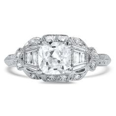 The Cristiano Ring Radiating light and style, this 18K white gold Art Deco-era ring features an old mine cut diamond accented by baguette and round brilliant cut diamonds for a shimmering look (approx. 1.18 total carat weight). $9,000