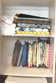 Organize your fabric by cutting up a cardboard box.