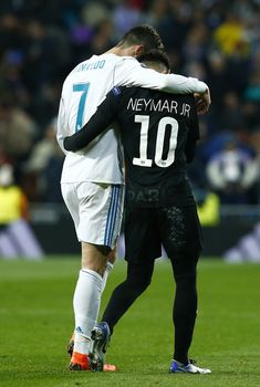 Cristiano Ronaldo Photos - Cristiano Ronaldo of Real Madrid and Neymar of PSG embrace at half time during the UEFA Champions League Round of 16 First Leg match between Real Madrid and Paris Saint-Germain at Bernabeu on February 14, 2018 in Madrid, Spain. - Real Madrid v Paris Saint-Germain - UEFA Champions League Round of 16: First Leg