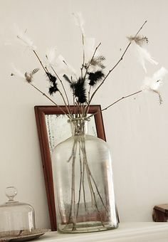 Black and white feathers on twigs in a jar. White Feathers, Spring Time, Glass Vase, Wedding Decorations, Jar, Easter, Contemporary, Black And White, House