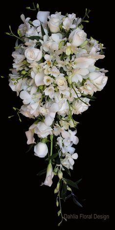 This website has lots of white and green arrangements    all white cascade teardrop wedding flower bridal party bouquet