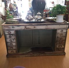 Here is the back view of the shop counter. See where the color is worn away inside where someone's feet rubbed. There are two drawers with locks which must have held the money. (one still does) I can imagine someone using this as a center piece in a very large dressing room to hold accessories or as a bar or console table. It would also make a great desk or ideally someone would use it for it's original purpose and make it a point of sales for their business. Would look amazing in a beauty…