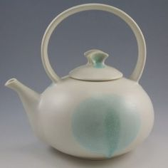 "Simon van der Ven's porcelain teapot  is one of the many on display at Lake Hebron Artisans in Monson for their second ceramic teapot show ""..."