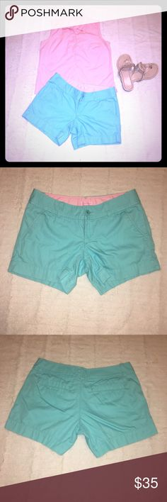 "Lilly Pulitzer Calla turquoise shorts Cover photo is just a cover photo, photo of item starts at 2 and up Used: Lilly Pulitzer Calla turquoise shorts, size 2,  5"" Inseam, Garment Washed, Zip Fly Short With Center Front Button Closure, Slant Front Pockets, And Back Welt Pockets. Beach Twill - PD (100% Cotton). Machine Wash Cold. Imported, has a small spot on the front near the bottom see photo. About 15"" width Lilly Pulitzer Shorts"