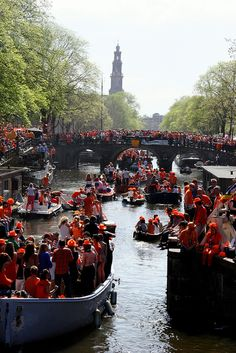 """Queen's Day on the canals in Amsterdam  Koninginnendag (Queen's Day), Netherlands: April 29 or 30 This is a national holiday and a """"free market"""" day, so everyone sells everything on the streets. There are games, concerts, performances, and parties on boats in the canals. Learn more about Koninginnendag."""