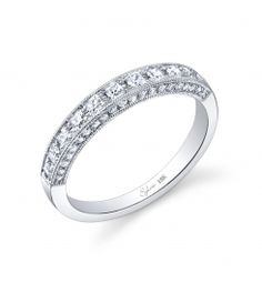 Gorgeous 18k white gold diamond wedding band. (For pricing on this diamond wedding band and other diamond wedding or engagement rings, contact a retailer near you.)