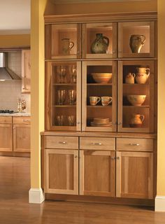 Built in hutch in Medallion Cabinetry Lancaster hickory
