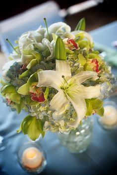 Sand Petal Weddings offers the convenient rental service of beach style centerpieces for ease to the traveling destination bride. Beach Wedding Reception, Wedding Reception Centerpieces, Wedding Table, Wedding Ideas, Orchids, Mason Jars, Lime, Table Decorations, Bridal