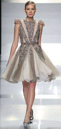 Tony Ward Couture      for the roses on the shoulders