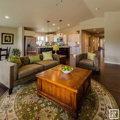 2015 North Idaho Building Contractors Association Parade of Homes - Greenstone Homes #paradecraze #paradeofhomes #GreenstoneHomes #greatroom #couch #rug #woodfloor #chair #pendantlight #kitchen #apples #green #design #interiordesign #designer #interiordesigner #decor #interiors #homedecor #homedesign #home #house #nibca #nibcaparadeofhomes #idaho #northidaho
