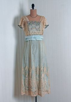 Cream and blue silk and lace dress.