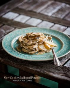 Slow Cooker Cheesy Scalloped Potatoes from White on Rice Couple via Slow Cooker from Scratch.