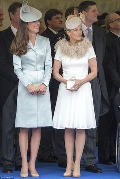 Strike a pose: The Duchess of Cambridge and Countess of Wessex adopt a similar stance as they watch the proceedings