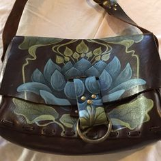 BIG MARKDOWNBoutique purchased Boho purse Never used-perfect condition! Beautiful hand painted/handmade boho bag. Chocolate brown with blue flower and green leaves. Bags Hobos