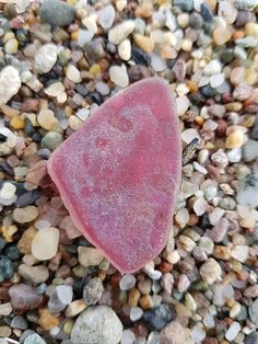 Pink sea glass with iridescent look on one sidegenuine surf