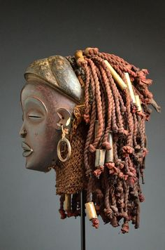 Africa | Pwo mask from the Chokwe people of Angola or DR Congo | Wood, metal, cloth, raffia and beads | ca. early to mid 20th century: