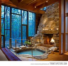 Stunning Indoor Fireplace and Hot Tub…yea this would totally go in the corner in one of the master suites, haha