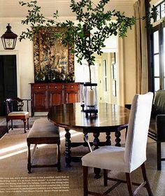 bench. table, lantern. rug, buffet, black trim on window/door....