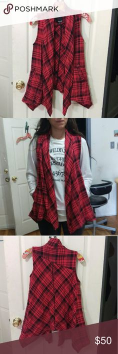 Volcom red plaid vest XS This EUC Volcom red plaid vest is 81% acrylic, 10% polyester, 6% cotton & 3% rayon. Nice, warm and cozy. It has 2 front pockets and cute draped style. I've styled this over a black leather jacket for an extra cool look! Size XS it can fit a size small easily. Free jewelry gift included with purchase of this item! Volcom Jackets & Coats Vests