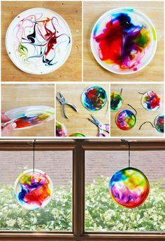Suncatcher craft for kids made from glue, food coloring, and recycled plastic lids BABBLE DABBLE DO