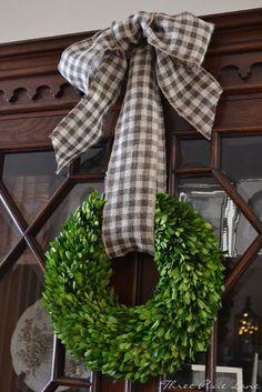 A Farmhouse Christmas {farmhouse Friday giant checked ribbon holds a wreath.....