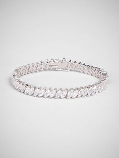 Traditional tennis bracelet styling gets an elegant update thanks to gorgeous marquise crystals in in a laser-like precise design.