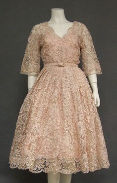 lovely lace. a-linle, 3/4 sleeves, v neck.  i'm pretty sure this dress would look bangin on me.