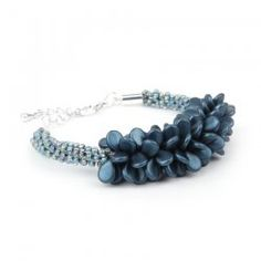 free pattern for Blue Coral Kumihimo Bracelet using pip beads & seed beads (maybe use 8° seed beads instead of 11° ?)