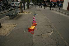 making Paris potholes colourful with knitting. by Juliana Santacruz Herrera