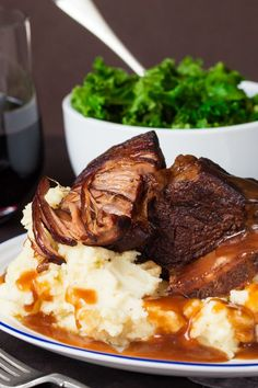 Crockpot Short Ribs with Rich Gravy - Fall-apart beef served with a rich and meaty red wine gravy. This is serious comfort food.