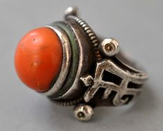 Saddle type ring with Mongolian writing and green enameling on gilt silver with coral. 19th c (private collection Linda Pastorino)