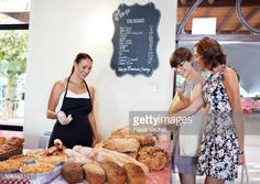 Foto de stock : Customers looking at bread at baker stall