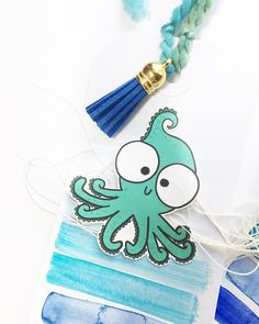Working on sea tags and this little octopus just might be my new mascot! What should his name be? #octopus #crafting #tagmaking #intheshop