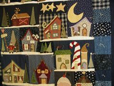"This is a long quilt that I did to put up to our front door in the winter to keep us warmer.  It is from ""Welcome to the North Pole""  by ""Piece of Cake Designs""."
