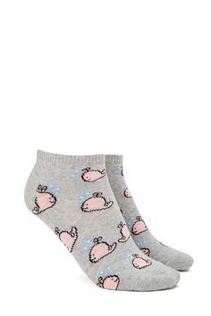 A pair of knit ankle socks with an allover whale pattern and ribbed trim.