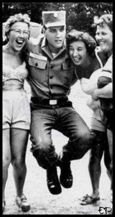Elvis clowning around with fans in Germany.