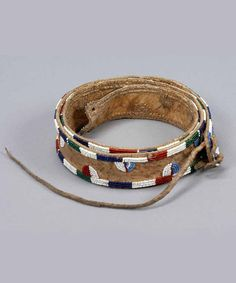 Africa | Belt from the Kikuyu people of Kenya | Animal hide (leather) and glass beads | Such belts (kiniata) are worn by circumcised boys. | ca. 1920 |  © UBC Museum of Anthropology.  No. 1293/2 African Dress, African Art, Native Style, Fashion Belts, Anthropology, Leather Jewelry, Traditional Dresses, Kenya, Beadwork