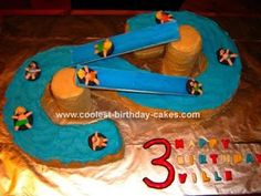 Water Slide Cake: I made this water slide cake for my son's third birthday and he absolutely loved it! I got the idea from the the Wilton website.  To make the towers I